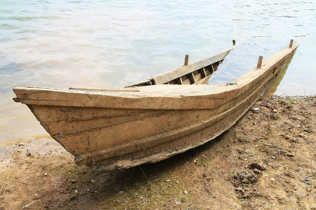 Ruin wooden boat sank on beach