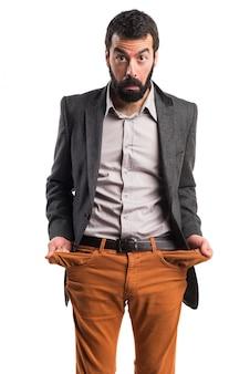 Разрушенный человек, ищущий деньги в карманах
