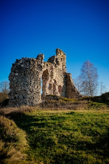 Ruined medieval castle on a sunny day in aizkraukle, latvia