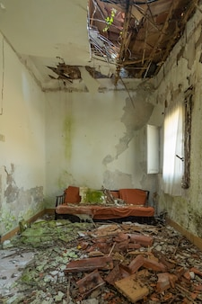 Ruined sofa to which the ceiling has fallen over