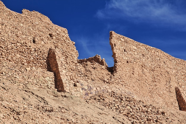 Ruins of ancient fortress in sahara desert