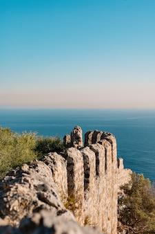 Ruins on the coast in the sea