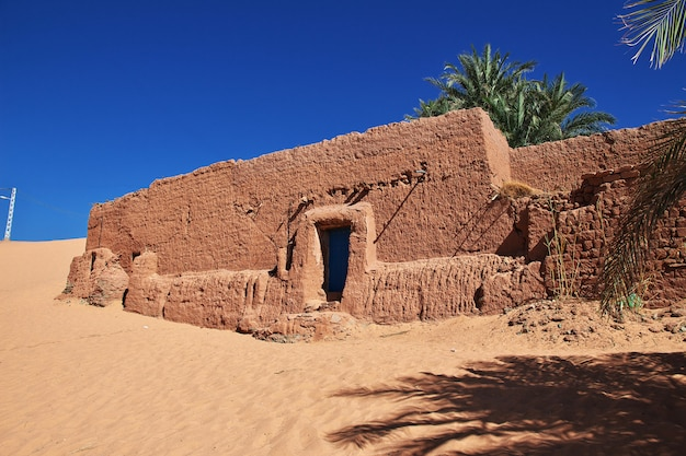 Ruins of a fortress in an abandoned city in sahara desert