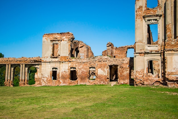 The ruins of a medieval castle in ruzhany. view of the ruined old palace complex with columns. brest region, belarus.