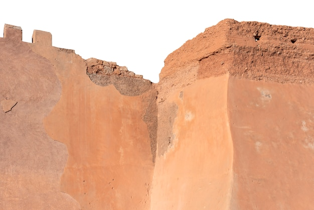 Ruins of an old arabian fortress, old wall in morocco, detail ruins of castle isolated