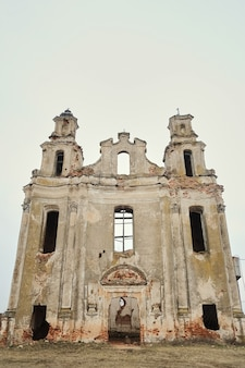Ruins of an old european catholic church on an autumn afternoon