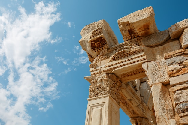 The ruins and ruins of the ancient city of ephesus against the blue sky on a sunny day.