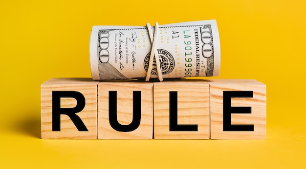 Rule with money on a yellow background. the concept of business, finance, credit, income, savings, investments, exchange, tax