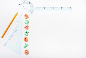 Rulers and pencil near figures