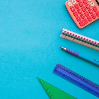 Rulers and pen near calculator