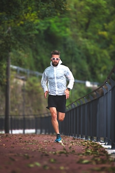Runner on bike path in autumn trains