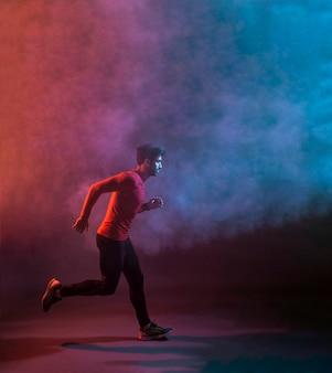 Runner in dark smoke of studio