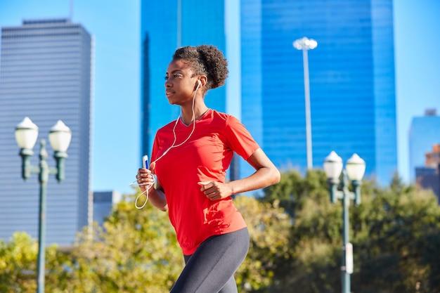 Runner girl running listening music earphones
