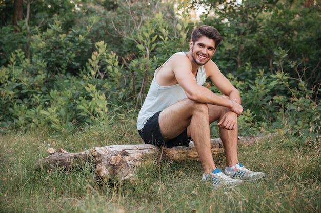 Runner resting in forest