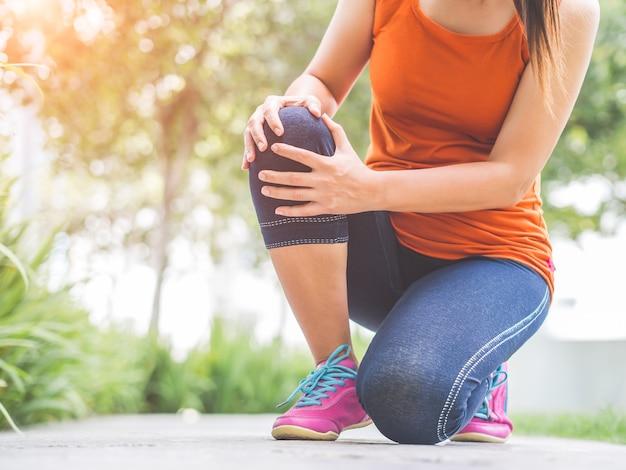Runner sport knee injury. woman in pain while running