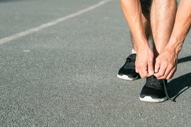 Runner tying shoelaces. track and field athletics. sports and active lifestyle.