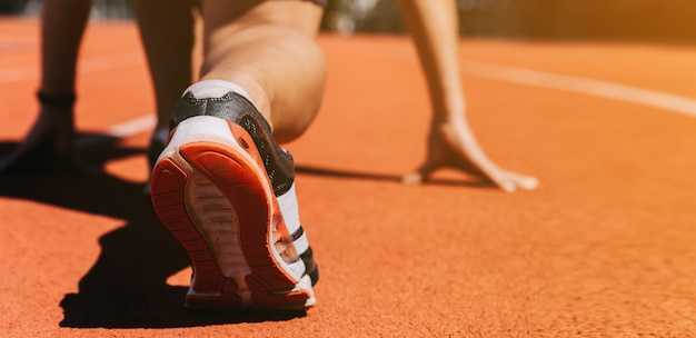 Runners feet in a athletic running track
