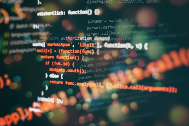 Running computer data / www programming. coding script text on screen. notebook closeup photo.