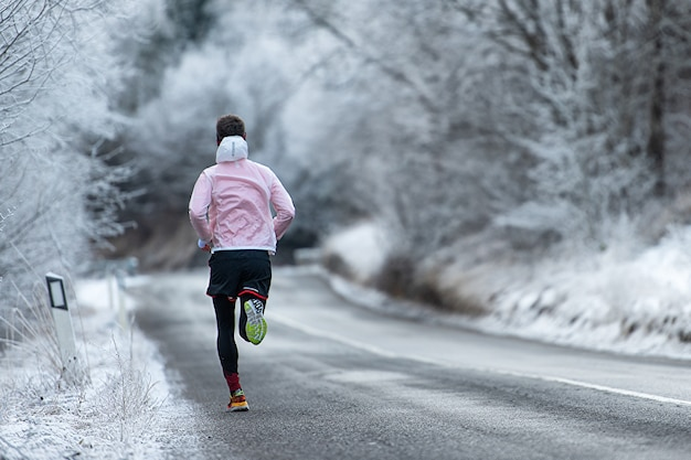 Running during training on icy road in winter