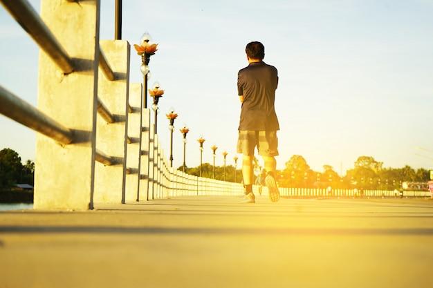 Running man runner jogging for fitness and health.