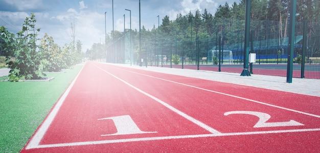 Running track in the sport stadium. rubber coating. athletic competitions starting line positions. school stadium. Premium Photo