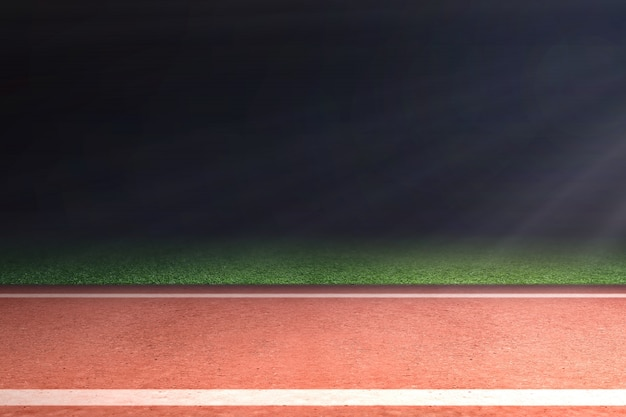 Running track with green grass and light