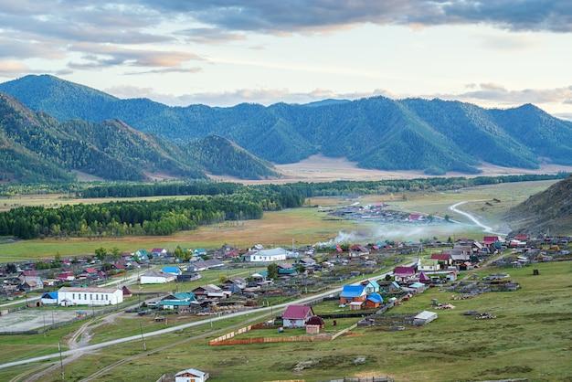 Rural autumn mountain landscape with a village russia mountain altai village of bichiktuboom