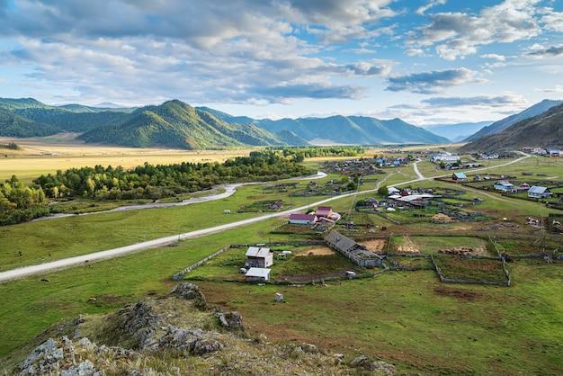 Rural autumn mountain landscape with a village russia mountain altai