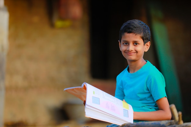 Rural indian boy studying at home