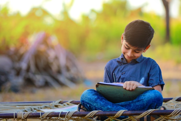 Rural indian child doing his homework at school