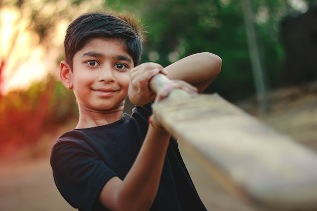 Rural indian child playing cricket