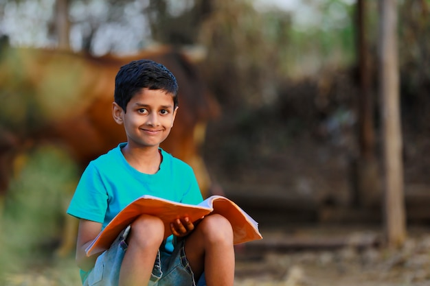 Rural indian child  studying at home