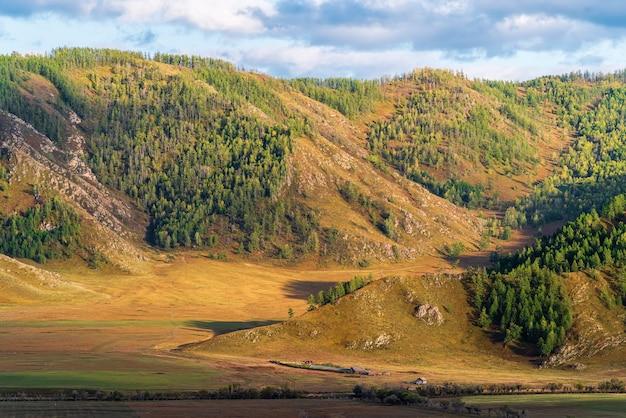 Rural mountain landscape in the fall russia mountain altai village of bichiktuboom