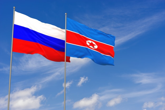 푸른 하늘 배경 위에 러시아와 북한 플래그입니다. 3d 일러스트레이션