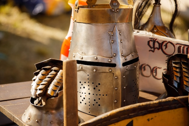 Russia. vyborg. 08.20.2020 medieval knight's helmets lie in nature. summer knights festival