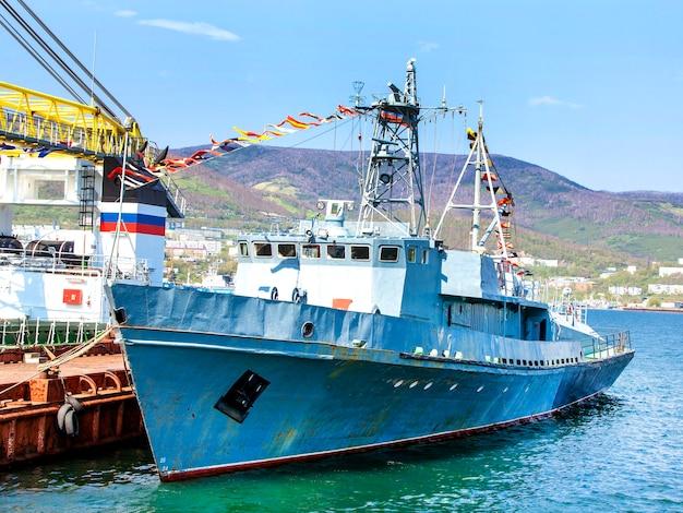 Russia warship with flags on kamchatka