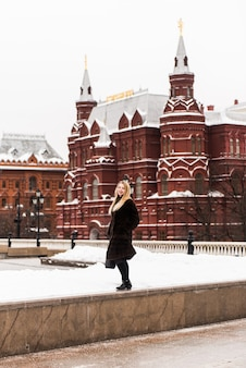 Russian beautiful woman in a mink coat on the red square in moscow