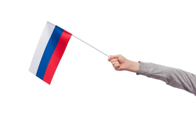 Russian flag in childs hand isolated on white . tricolor flag of white blue red.