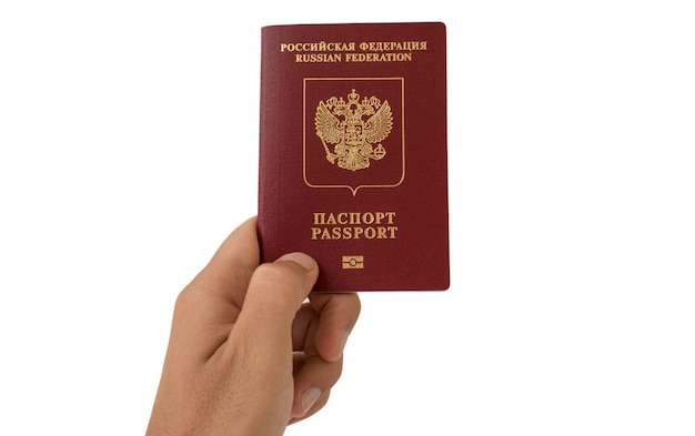 Russian foreign passport in the hand isolated on white background