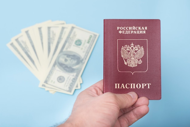 Russian international passport in the man's hand.
