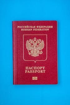 Российский загранпаспорт на синем фоне макета