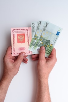 Russian international passport with euro in the man's hand