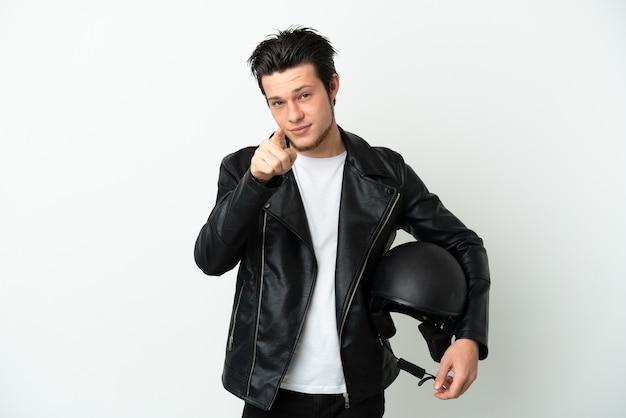 흰색 배경에 놀라게 하 고 앞을 가리키는에 고립 된 오토바이 헬멧 러시아 남자