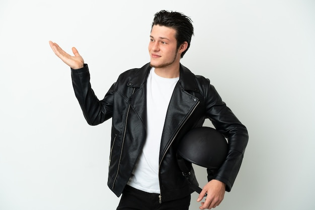 Russian man with a motorcycle helmet isolated on white background extending hands to the side for inviting to come