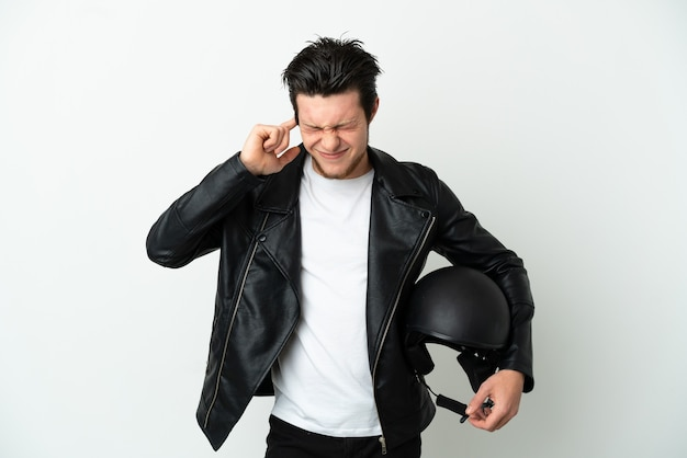 Russian man with a motorcycle helmet isolated on white background frustrated and covering ears