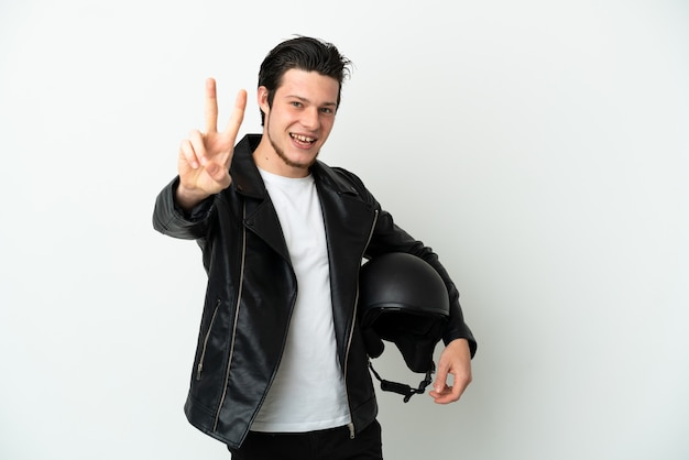 Russian man with a motorcycle helmet isolated on white background smiling and showing victory sign