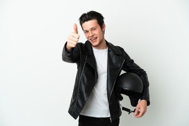 Russian man with a motorcycle helmet isolated on white background with thumbs up because something good has happened