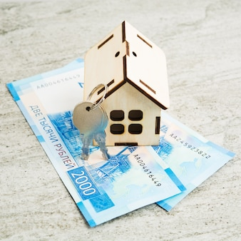 Russian new banknotes of 2000 rubles with wooden house and keys