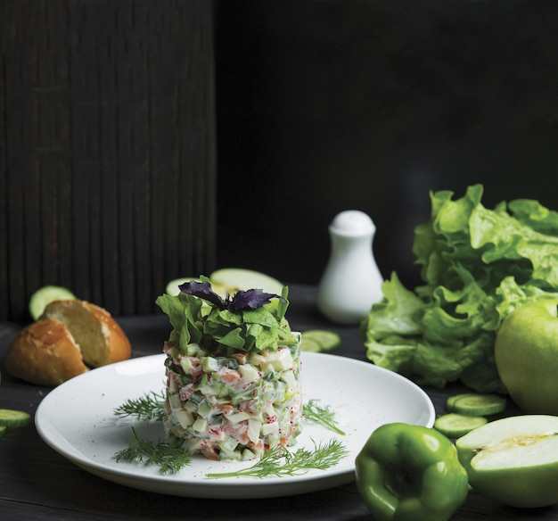 Russian olivie salad with green herbs