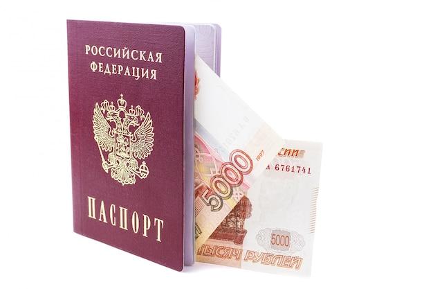 Российский паспорт и рубли банкноты Premium Фотографии